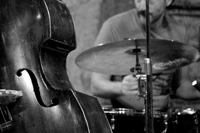 a person playing bass and drums