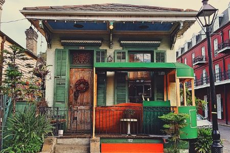 """a green and white """"shotgun"""" house in new orleans"""