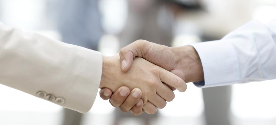 a trusted realtor shaking hands with a buyer